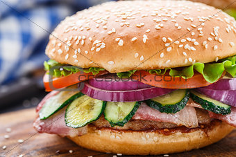 Bacon burger with vegetables and cutlet.