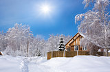 Wooden Siberian house in winter snow