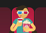Young guy sitting in the cinema