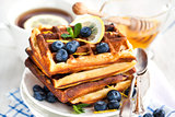 Lemon blueberry waffles with honey