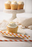 Sweet vanilla cupcake with straws