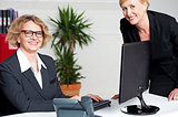 Businesswomen sitting in modern office