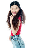 Slim young smiling chinese girl over white