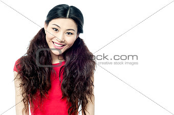 Adorable young smiling girl with long hair