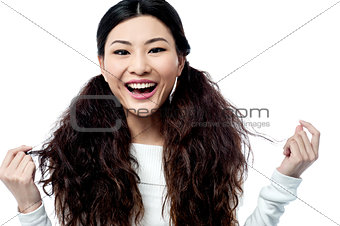 Attractive young smiling chinese girl