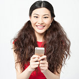 Young smiling girl using cell phone