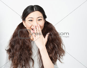 Astonished young chinese girl