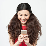 Pretty amused girl reading funny sms