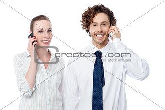 Business people communicating thru mobile phone
