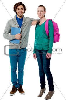 Boy resting her arm on classmates shoulder