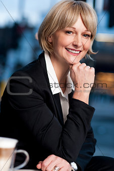 Smiling business woman posing in style