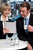 Cheerful business people using digital tablet