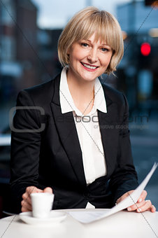 Corporate women in cafe with financial reports