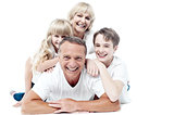 Cheerful family of four isolated on white