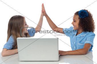 Cute little school girls with laptop
