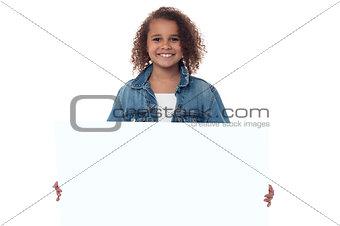 Little girl behind blank whiteboard