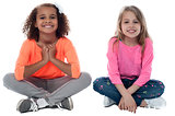 Little girls sitting on floor