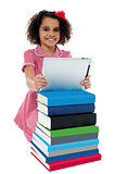 Cute little curly haired girl using tablet pc