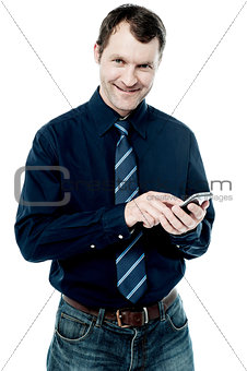Business executive using his cell phone