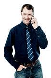 Male executive talking via mobile phone