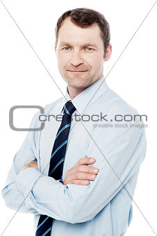 Smiling arms crossed business executive