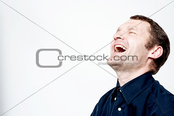 Portrait of hard laughing man