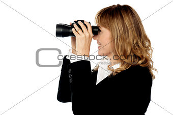 Attractive woman viewing through binocular