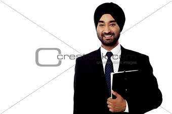 Corporate executive holding a folder