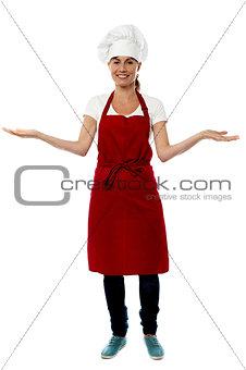 Beautiful woman chef welcoming