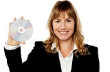 Smiling female manager showing compact disc