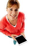 Woman holding new tablet pc, aerial view