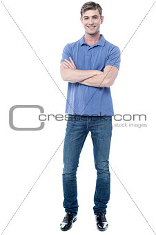 Smart young man with crossed arms
