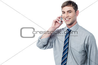 Smart executive talking in his mobile phone