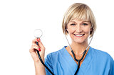 Middle aged female doctor with a stethoscope
