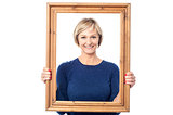 Middle aged lady holding photo frame