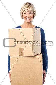 Beautiful woman carrying cardboard boxes