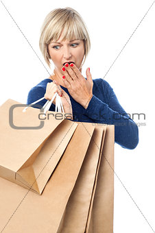 Amazed shopping woman isolated on white