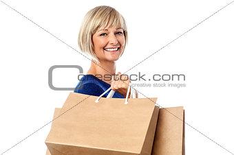 Beautiful lady carrying shopping bags