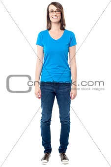 Casual middle aged woman posing over white