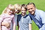 Lovable family enjoying sunny day outdoors