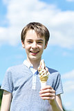 Smiling boy posing with an ice cream