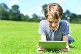 Young boy playing on tablet pc