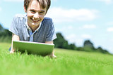 Handsome young boy with tablet device, outdoors.