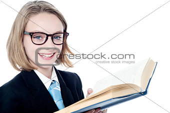 Smiling business girl holding a book