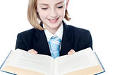 Smiling teen girl looking at a book