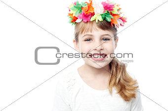 Little girl in wreath of flowers