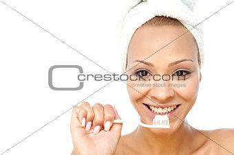 Beautiful woman brushing her teeth