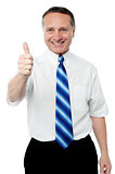 Senior mature man giving thumbs up