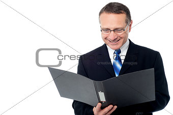 Smart businessman holding a open file