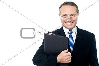 Smiling businessman holding file folders